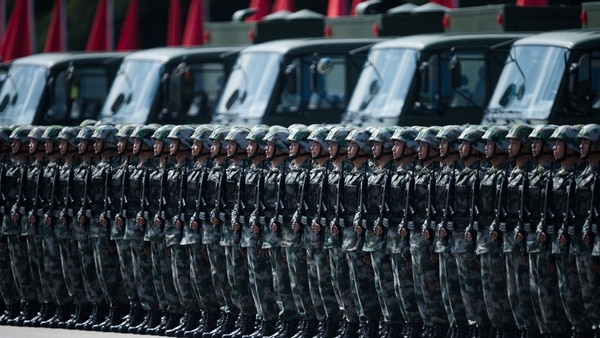 People's Liberation Army soldiers prepare for the arrival of Chinese President Xi Jinping at the Shek Kong barracks in Hong Kong on June 30, 2017. (Dale de la Rey/AFP via Getty Images)