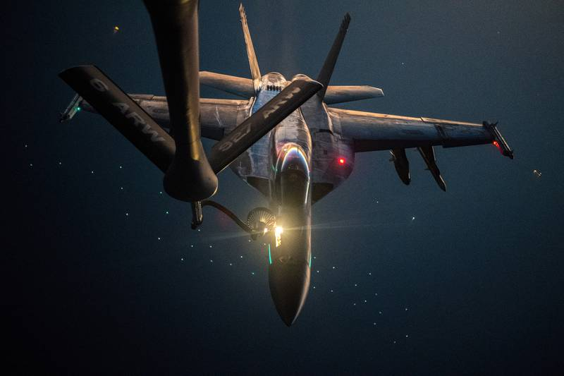 A U.S. Navy F/A-18E Super Hornet is refueled over the U.S. Central Command area of responsibility by a U.S. Air Force KC-135 Stratotanker, Sept. 22, 2020.