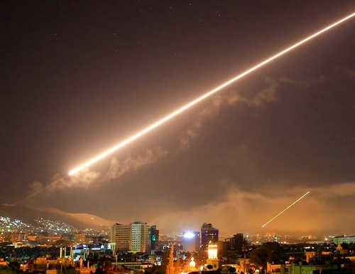 Damascus skies erupt with surface to air missile fire as the U.S. launches an attack on Syria targeting different parts of the Syrian capital Damascus, Syria, early Saturday, April 14, 2018. (Hassan Ammar/AP)