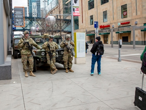 Members of the National Guard stand ready in downtown Minneapolis on April 20 as the jury deliberates in the trial of former police officer Derek Chauvin in the death of George Floyd. (Ted Shaffrey/AP)