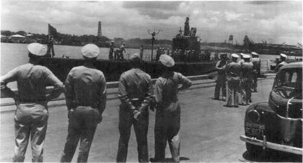 The submarine Trout returns to Pearl Harbor in 1942. Its crew members would all receive Silver Star Medals for their actions during World War II. (Naval History and Heritage Command)