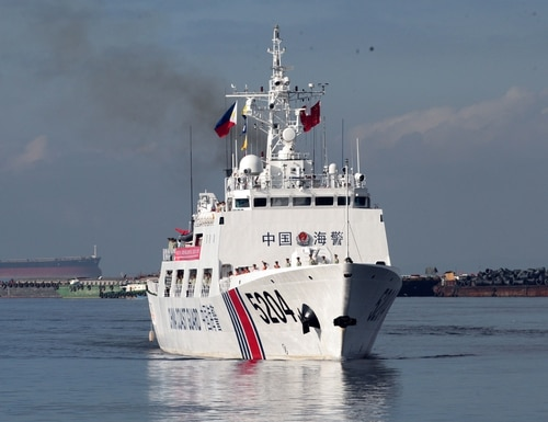A Chinese Coast Guard ship prepares to anchor in Manila, Philippines, on Jan. 14, 2020, for a port call. (AFP via Getty Images)