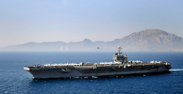 The aircraft carrier Harry S. Truman transits the Strait of Gibraltar. (U.S. Navy)