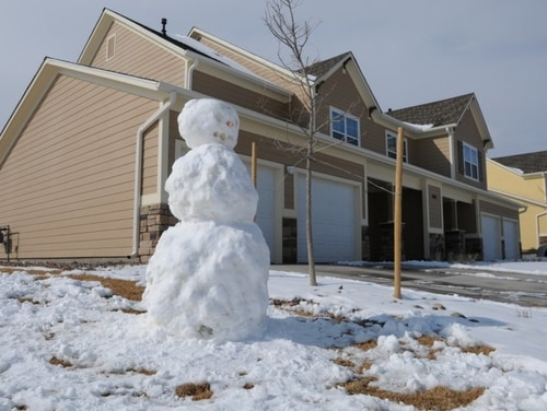 Residents of Army privatized housing will no longer be getting utility bills, at least for now, the service announced. Here, a snowman stands sentinel at a housing area at Fort Carson, Colorado. (Sgt. Eric Glassey, Army)