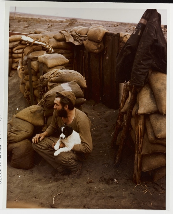 A bearded sailor and his dog at a Navy salvage depot inside the Anzio beachhead on April 15, 1944. (National Archives)