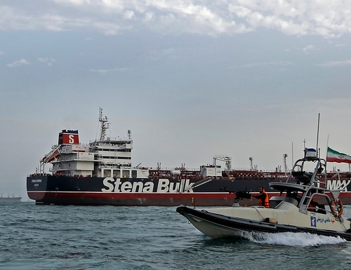 In this July 21, 2019, file photo, a speedboat of the Iran's Revolutionary Guard moves around a British-flagged oil tanker Stena Impero, which was seized on Friday by the Guard, in the Iranian port of Bandar Abbas. The movement of the Stena Impero on Tuesday, Sept. 24, comes after a government spokesman in Iran on Monday said legal proceedings against the vessel had concluded.(Hasan Shirvani/Mizan News Agency via AP, File)