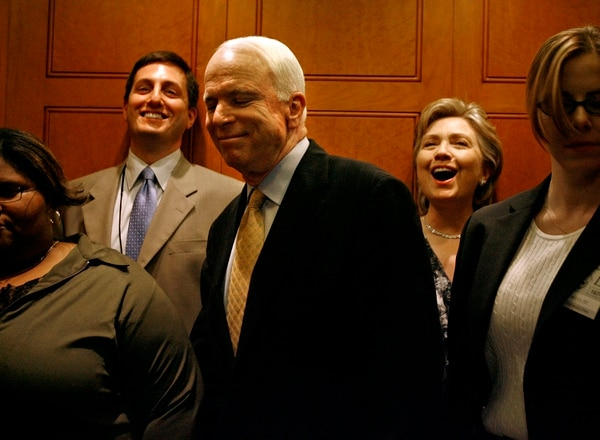 WASHINGTON - MARCH 27: Sen. John McCain (R-AZ) (3rd L) smiles as Sen. Hillary Clinton (D-NY) (2nd R) reacts to him getting on the same elevator after a vote at the US Capitol March 27, 2007 in Washington, DC. Both senators have announced they are running for the US presidency. The Democrats successfully voted down 48-50 an amendment by Sen. Thad Cochran (R-MS) to remove an troop withdrawal date from an Iraq spending bill. (Photo by Chip Somodevilla/Getty Images)
