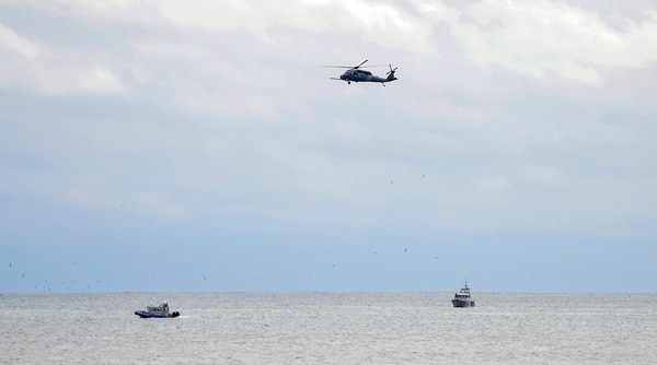 Rescue personnel search for a plane that crashed into the waters off Quogue on New York's Long Island on Saturday. (James Carbone/Newsday via AP)