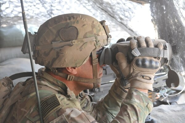 Sgt. Arturro Hernandez of Apache Troop, 1st Squadron, 75th Cavalry Regiment, Task Force Strike, looks through his binoculars during his guard shift June 18, 2016, at Kara Soar Base, Iraq. Part of Troop A's mission is protecting the artillery responsible for the fires at the Kara Soar Base. The fires at the Kara Soar Base serve two roles: force protection for Coalition and Iraqi security forces and fire in support of maneuver, enabling ISF to defeat Daesh. (U.S. Army photo by 1st Lt. Daniel Johnson/Released)