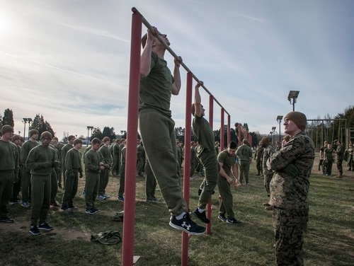 Marine Officer Candidates from Charlie and Delta Company attending Officer Candidate Class-220 complete their initial Physical Fitness Test (PFT) at Brown Field aboard Marine Corps Base Quantico, Virginia, Jan. 20, 2016. (Cpl Patrick H. Ownes/Marine Corps)
