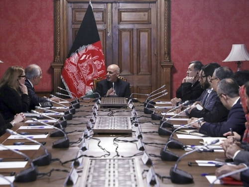 In this photo released by Afghanistan's Presidential Palace, Afghan president Ashraf Ghani, center, talks with US special representative for Afghan Peace and reconciliation Zalmay Khalilzad top left, at the presidential palace in Kabul. Afghanistan, Monday, Jan. 28, 2019. (Afghan Presidential Palace via AP)
