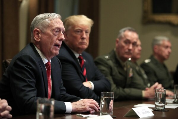 Defense Secretary Jim Mattis, from left, with President Donald Trump, Chairman of the Joint Chiefs of Staff Gen. Joseph Dunford and Marine Corps Commandant Gen. Robert Neller, speaks during a briefing with senior military leaders in the White House on Oct. 23, 2018. (Manuel Balce Ceneta/AP)