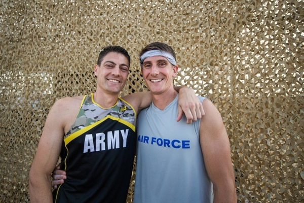 Army Lt. Col. Eric Palicia, left, U.S. Army Germany, Wiesbaden, and his brother, Air Force Capt. Noah Palicia, 374th Operations Group C130J instructor pilot, Yokota Air Base, Japan, competed in the 2019 Air Force and inter-service Alpha Warrior Battles Sept. 12 at the Alpha Warrior Proving Grounds, Selma, Texas. (Sarayuth Pinthong/Air Force)