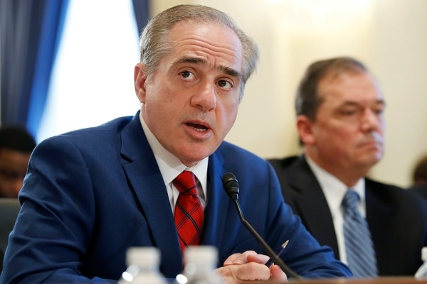 Veterans Affairs Secretary David Shulkin, left, next to James Manker, the VA's acting principal deputy undersecretary for benefits, speaks about the FY19 budget before the House Veterans Affairs Committee Feb. 15. The secretary on Tuesday insisted he has put weeks of controversy behind him and is moving ahead with reform work at VA. (Jacquelyn Martin/AP)