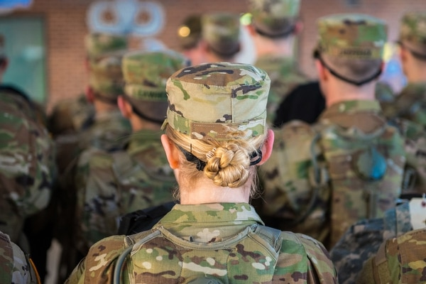 One of the first women to enlist in the infantry stands in formation on day one of one-station unit training at Fort Benning, Ga. (Patrick A. Albright/Army)