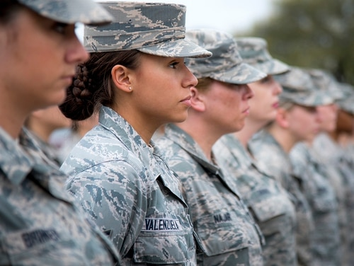 Air Force personnel from the 96th Medical Group stands at parade rest as part of an all-female formation prior to the base retreat ceremony on March 30, 2017, at Eglin Air Force Base in Florida. (Samuel King Jr./Air Force)