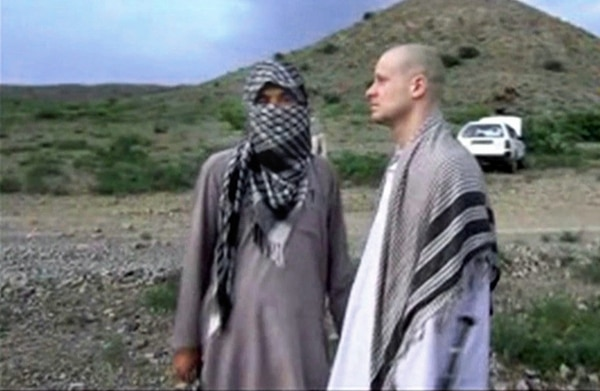 FILE - In this file image taken from video obtained from Voice Of Jihad Website, which has been authenticated based on its contents and other AP reporting, Sgt. Bowe Bergdahl, right, stands with a Taliban fighter in eastern Afghanistan. Bergdahl was freed in a swap in which the U.S. freed five Taliban detainees, a diplomatic victory for the insurgent group. In a belt from Iraq to Pakistan, militants scored a series of successes the past weeks, a sign of their continued power 13 years into the U.S.