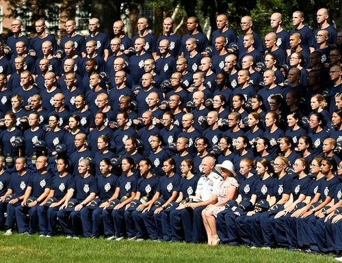 In a July 1, 2019, file photo, U.S. Coast Guard Academy Superintendent Rear Adm. William G. Kelly and his wife Angie pose with the Class of 2023 for their class photo on Day One of Swab Summer in New London, Conn. (Sean D. Elliot/The Day via AP, File)