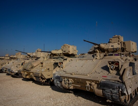 Bradley fighting vehicles are parked at a US military base at an undisclosed location in northeastern Syria, Monday, Nov. 11, 2019. (Darko Bandic/AP)
