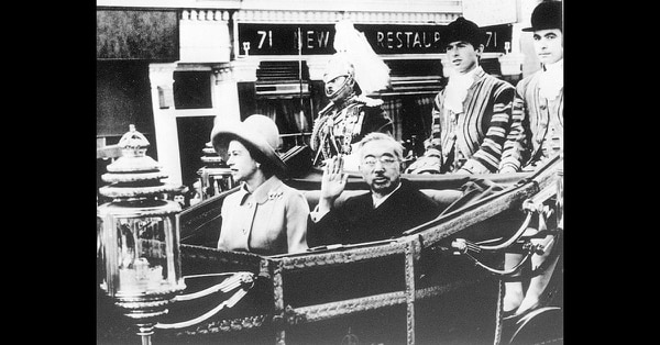 In this Oct. 5, 1971, photo, Emperor Hirohito, center right, and Queen Elizabeth II, center left, are in a carriage on their way to the Buckingham Palace as part of his tour to Europe. (Kyodo News via AP)