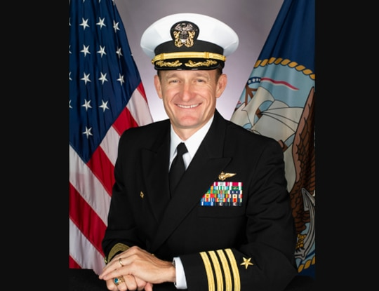 Capt. Brett Crozier, fired Thursday as the skipper of the aircraft carrier Theodore Roosevelt, has tested positive for COVID-19, the New York Times reports. (Navy)