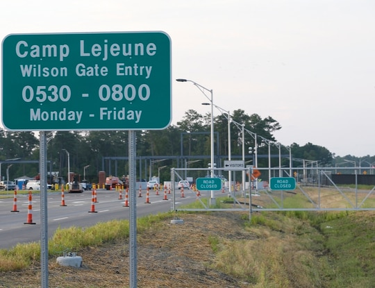In this July 31, 2014, file photo, traffic moves onto Camp Lejeune in Jacksonville, N.C., as access to via the now open Wilson Gate goes into effect. (John Althouse/The Daily News via AP)