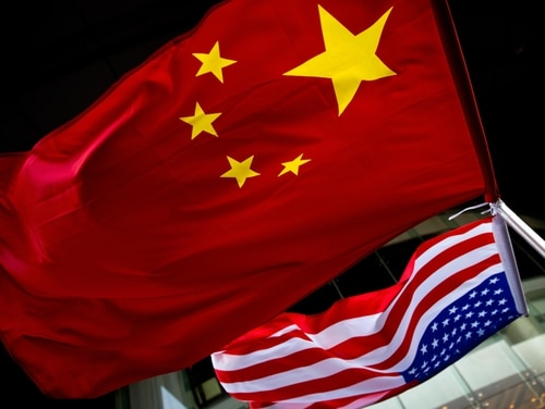 In this Nov. 7, 2012, photo, U.S. and Chinese national flags are hang outside a hotel during the U.S. presidential election event, organized by the U.S. embassy in Beijing. (Andy Wong/AP)