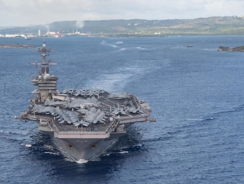 The aircraft carrier Theodore Roosevelt departs Apra Harbor, Guam, July 4, following an extended visit in the midst of the COVID-19 global pandemic. (MCSN Kaylianna Genier/Navy)