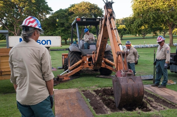 National Memorial Cemetery of the Pacific caretakers prepare grave sites for a disinterment on Nov. 8, 2015. The disinterment was part of a dignified transfer of the last unknown service members who lost their lives on board the battleship Oklahoma on Dec. 7, 1941. (Air Force)
