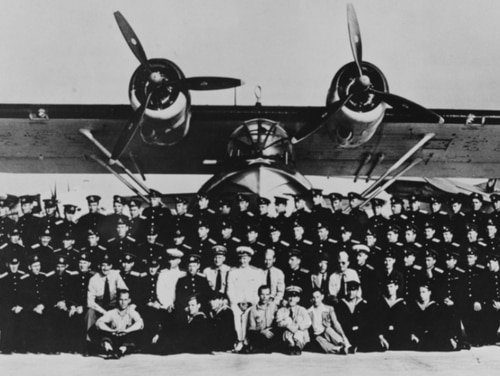 Soviet naval personnel pose with U.S. Navy instructors during training for ferrying lend-lease PBN-1 patrol bombers, at Elizabeth City, North Carolina, 1944. The plane behind them is a PBN-1 in Soviet markings. Each crew received about 80 hours of flight training, plus ground school instruction. (National Archives)