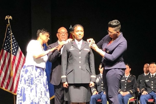Family members of 1st Lt. Janeen Phelps pin on her new rank during a ceremony at the University of Nevada, Las Vegas, in May 2018. (Courtesy of the Phelps family)