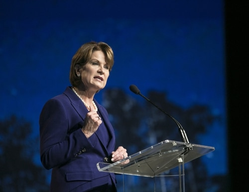 Marillyn Hewson, chairman, president and CEO of Lockheed Martin, speaks at the Norway F-35 rollout celebration at Lockheed Martin in Fort Worth, TX, on Tuesday, Sep. 22, 2015. (Laura Buckman/AFP/Getty Images)