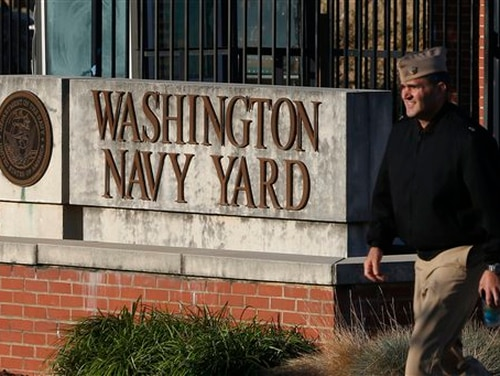 In this Sept. 19, 2013, file photo. military personnel walks past an entrance to the Washington Navy Yard in Washington. (Charles Dharapak/AP)