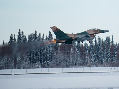 A U.S. Air Force F-16 Fighting Falcon fighter aircraft assigned to the 18th Aggressor Squadron takes off from Eielson Air Force Base, Alaska, Oct. 6, 2014, during RED FLAG-Alaska 15-1. RF-A is a series of Pacific Air Forces commander-directed field training exercises for U.S. and partner nation forces, providing combined offensive counter-air, interdiction, close air support and large force employment training in a simulated combat environment. (U.S. Air Force photo by Tech. Sgt. Joseph Swafford Jr./Released)