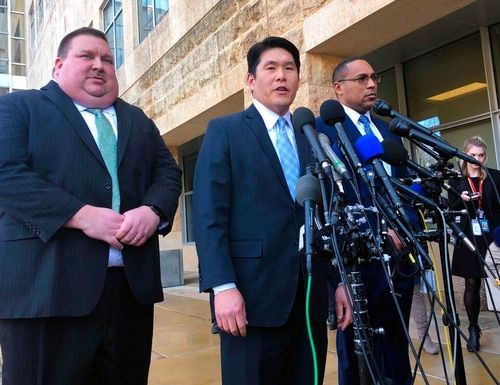 U.S. Attorney Robert Hur, center, of the District of Maryland, speaks as Art Walker, left, special agent from the Coast Guard investigative service, and Gordon Johnson, special agent in charge of the FBI's Baltimore office, listen during a news conference about Coast Guard Lt. Christopher Paul Hasson, Thursday, Feb. 21, 2019, outside the federal courthouse in Greenbelt, Md. Hasson is suspected of drawing up a hit list of top Democrats and network TV journalists spent hours on his work computer researching the words and deeds of infamous bombers and mass shooters while also stockpiling weapons, federal prosecutors said Thursday. (Michael Kunzelman/AP)