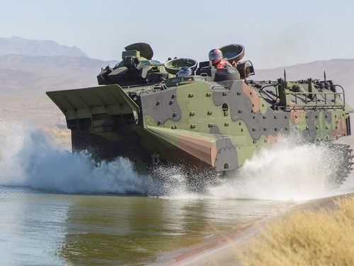 Pentagon employees roll the Assault Amphibious Vehicle into a testing pond aboard Marine Corps Logistics Base Barstow, Calif., on Aug. 27, 2018. (Jack J. Adamyk/U.S. Marine Corps)