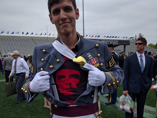 Second Lt. Spenser Rapone posted a photo on Twitter of himself posing with a Che Guevara t-shirt under his uniform at his graduation from West Point. (Via Twitter)