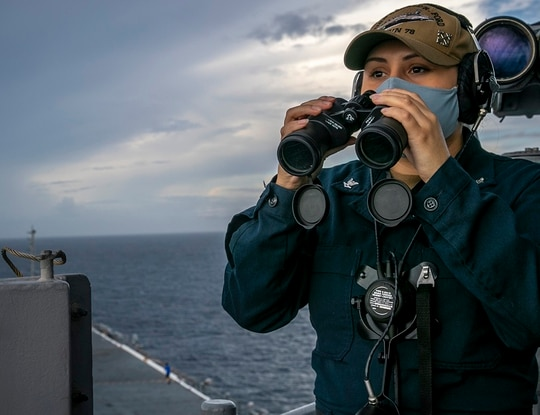 Boatswain's Mate 3rd Class Teddi Young, assigned to the aircraft carrier Gerald R. Ford's deck department, stands lookout watch on the forward bridge wing Sept. 8 in the Atlantic Ocean. Young is one of the
