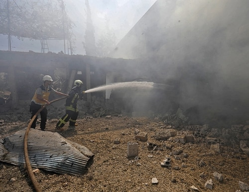 Syrian firefighters try put out a fire in a building that was hit by reported Russian airstrikes in the rebel-hold town of Jadraya, about 35 kilometers southwest of the city of Idlib, on Sept. 4, 2018. (Omar Haj Kadour/AFP via Getty Images)