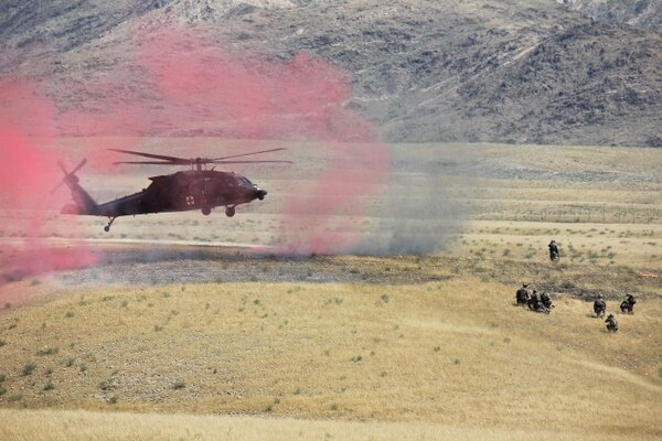 101st Airborne Division Soldiers prepare to evacuate a casualty as an HH-60 Black Hawk helicopter lands during a combined arms live-fire training exercise at Tactical Base Gamberi May 13, 2015. The exercise was conducted by Train Advise Assist Command-East to demonstrate opportunities for the 201st Afghan National Army Corps to plan, manage and conduct combined arms training on their ranges. (Army)