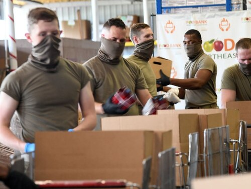 Soldiers with the Louisiana National Guard's 527th and 528th Engineer Battalions, 225th Engineer Brigade, package food to be distributed to residents in need during the COVID-19 response at Northeast Louisiana Food Bank in Monroe on April 23, 2020. (Staff Sgt. Thea James/Army National Guard)
