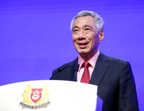 Singaporean Prime Minister Lee Hsien Loong delivers a keynote address during the opening dinner of the 18th International Institute for Strategic Studies (IISS) Shangri-la Dialogue, an annual defense and security forum in Asia, in Singapore, on Friday. (Yong Teck Lim/AP)