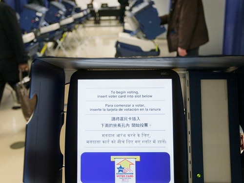 In this Feb. 27, 2012, file photo, voters cast their ballots on voting machines in Chicago. Illinois, officials expect to receive $13 million in federal funds to help update aging voting machines across the state. The money is part of a $380 million congressional influx to prevent a repeat of Russian interference in the 2016 elections, but is it enough? (M. Spencer Green/AP)