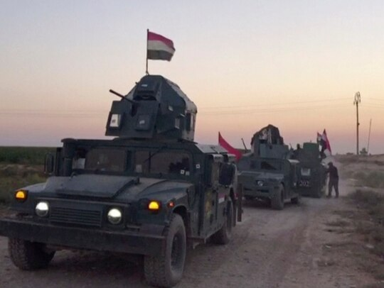 This image made from a video shows Iraqi soldiers on military vehicles in the Qatash area towards Kirkuk gas plant, south of Kirkuk, Iraq, Monday, Oct. 16, 2017. Iraqi state media say federal troops have entered disputed territories occupied by the nation's Kurds. The move comes three years after Kurdish militias seized the areas outside their autonomous region to defend against an advance by the Islamic State extremist group. (APTN via AP)