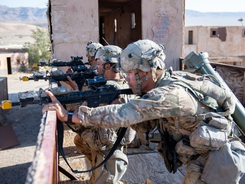 Infantrymen look for the opposing force during an early morning mission at the National Training Center, Fort Irwin, California, on July 25. (Sgt. Sebastian Nemec/Army)