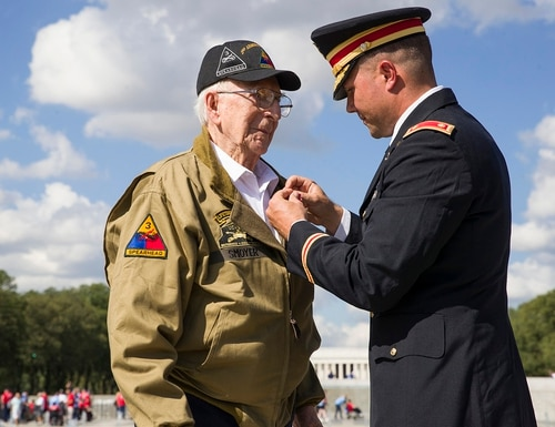 World War II veteran Clarence Smoyer, 96, receives the Bronze Star from U.S. Army Maj. Peter Semanoff at the World War II Memorial, Wednesday, Sept. 18, 2019, in Washington. (Alex Brandon/AP)