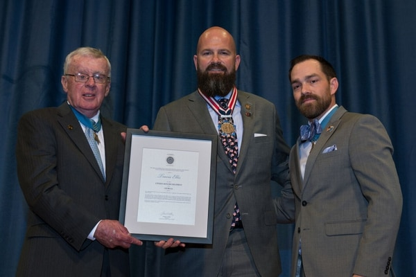 2017 Citizen Honors Award Acts of Service recipient, Mr. Travis Ellis (Senoia, Georgia) receives the 2017 Citizen Honors Award Acts of Service from Medal of Honor Recipients Tom Kelley and Clinton Romesha. (Courtesy of the Congressional Medal of Honor Foundation)