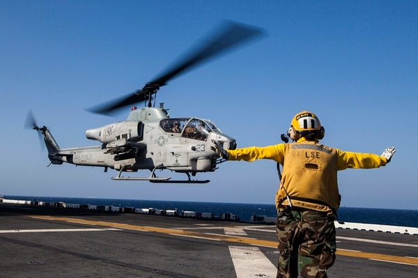 An AH-1W Super Cobra helicopter with Marine Medium Tiltrotor Squadron (VMM) 263 (Reinforced), 22nd Marine Expeditionary Unit (MEU), lands aboard the USS Bataan (LHD 5). The AH-1W and UH-1Y aircraft markings were hand painted or custom created by MEU Marines to commemorate Medal of Honor and Navy Cross recipients. The 22nd MEU is deployed with the Bataan Amphibious Ready Group as a theater reserve and crisis response force throughout U.S. Central Command and the U.S. 5th Fleet area of responsibility. (U.S. Marine Corps photo by Sgt. Austin Hazard/Released)
