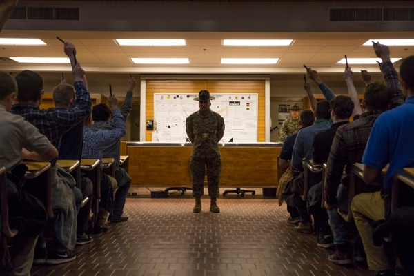 Marine Corps Sgt. Luis M. Lora gives recruits of Echo Company, 2nd Recruit Training Battalion, orders as they begin their processing Jan. 8, 2018, on Parris Island, S.C. (Cpl. Vanessa Austin/Marine Corps)