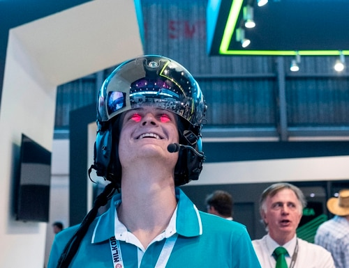 A man wears a German-made Hensoldt BAE Striker-II Helmet during the 2018 Africa Aerospace and Defence Expo. Hensoldt announced the acquisition of Austria's Sail Labs in early 2021 aimed at bolstering its data analytics portfolio. (Wikus de Wet/AFP via Getty Images)